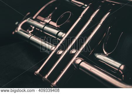 Close Up Of The Valves Of A Trumpet On A Black Background. Details Of A Trumpet