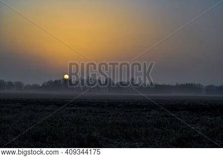 Orange Sunrise Over Agriculture Fields A Misty Morning