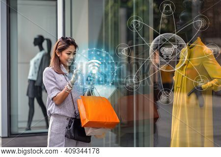 Asian Woman Using The Smart Mobile Phone For Check Online Shopping Order Is Completed Via Omni Chann