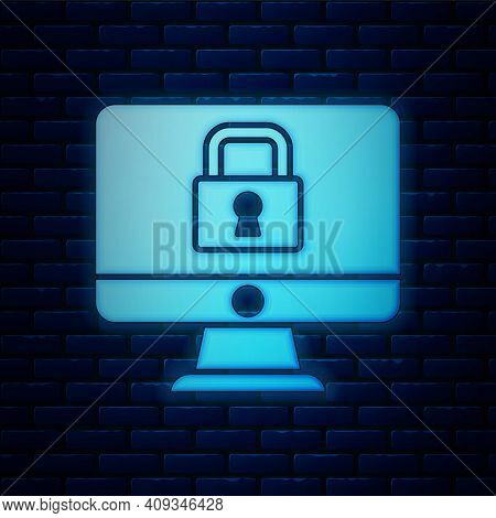 Glowing Neon Lock On Computer Monitor Screen Icon Isolated On Brick Wall Background. Security, Safet