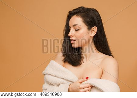 Attractive Young Woman In Underwear While Standing Against Beige Background. Beautiful And Healthy F