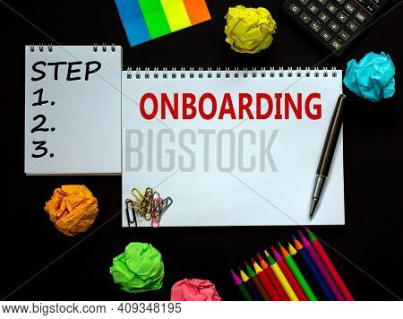 Onboarding Symbol. White Note With A Word 'onboarding' On Beautiful Black Background, Colored Paper,