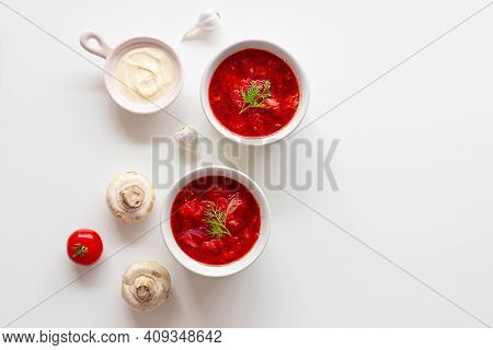 Homemade Traditional Ukrainian Beet Soup With Fresh Green Dill. Russian Borscht In Bowl Of Tomatoes,