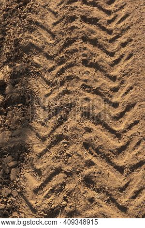Tractor Tracks On Arid And Dry Terrain