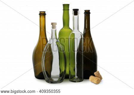 White Wine Bottle And White Oval Vodka Bottle Near Green Wine Bottle, Brown Wine Bottles Isolated On