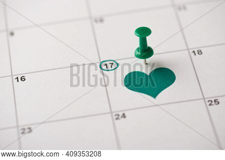 St. Patrick's Day Is Coming Concept. Cropped Close Up View Photo Picture Of Pushpin Attached To The