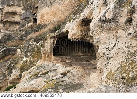 View Of The Ruins Of A Medieval Cave City-fortress On A Rocky Slope