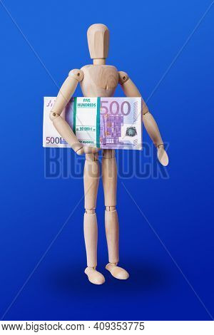 Wooden toy figure with euro money on blue background