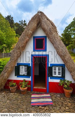 Traditional Madeira house in Santana Portugal - travel background