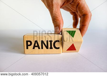 Time To Stop Panic Symbol. Businessman Holds A Cubes With Up Icon. Wooden Cube With Word 'panic'. Be