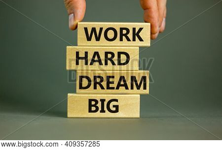 Work Hard Dream Big Symbol. Concept Words 'work Hard Dream Big' On Wooden Blocks On A Beautiful Grey