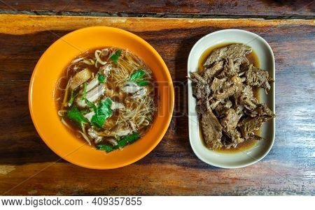 Rice Vermicelli With Stewed Duck Meat (duck Noodle) And Boiled Duck Wing Stewing In Soy Sauce On Woo