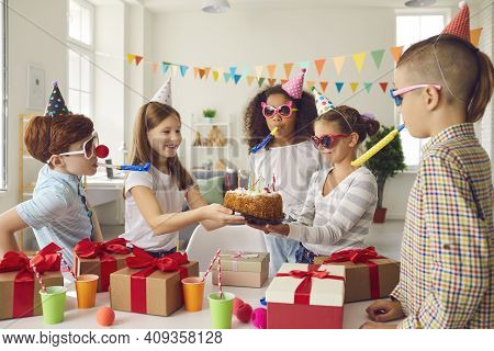Diverse Children In Party Hats And Funny Sunglasses Are Having Fun At A Childrens Birthday Party.