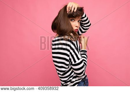 Photo Shot Of Cute Attractive Pretty Young Brunette Woman Wearing Casual Striped Longsleeve Isolated