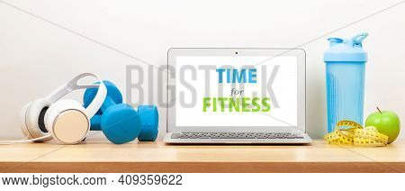 Healthy lifestyle, fitness, sport and online technology concept. Laptop and workout equipment. With copy space for your text or app