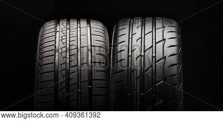 Two New Summer Modern Tires On A Dark Background