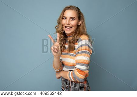 Portrait Of Happy Joyful Young Beautiful Blonde Curly Woman With Sincere Emotions Wearing Stylish St
