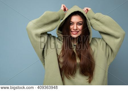 Portrait Of Attractive Young Caucasian Smiling Brunette Woman Model In Trendy Khaki Hoodie And Weari