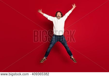 Full Length Body Size Photo Of Crazy Aged Man Jumping High Playful Childish Pretending Star Isolated