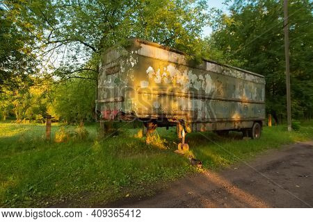 Old Rusty Aluminum Steel Metal Caravan Trailer Painted In Military Khaki Green In Bright Happy Summe