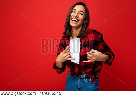 Young Beautiful Happy Smiling Brunette Woman Wearing Trendy White T-shirt And Red Check Shirt . Sexy