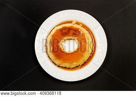 An Eggs Flan On A White Ceramic Plate