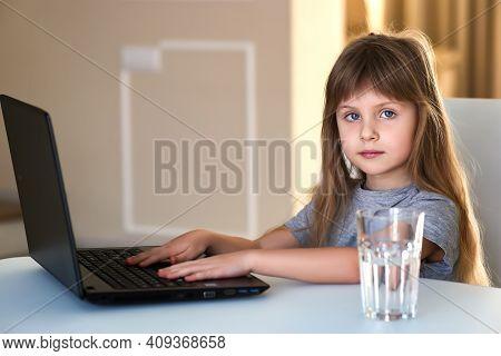 European Girl Using Laptop For Online Study During Homeschooling At Home. Homeschooling, Online Stud