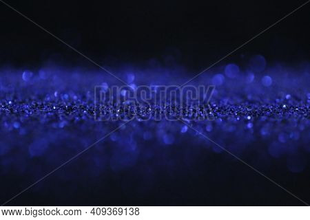 Wallpaper Phone Shining Glitter.glitter Radiance Surface. Blue Glitter On A Black Background.festive