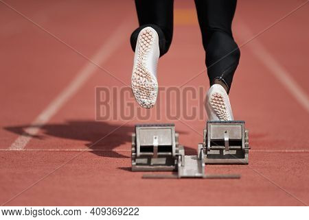 Back View Of Male Feet On Starting Block Ready For A Sprint Start