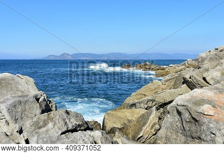 View From A Cliff With Waves Breaking At Famous Rias Baixas In Galicia Region. Porto Do Son, Coruña,