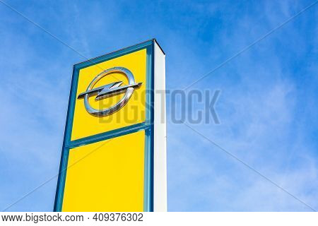 Opel Brand Logo On Bright Blue Sky Background Located In Lyon, France - February 23, 2020