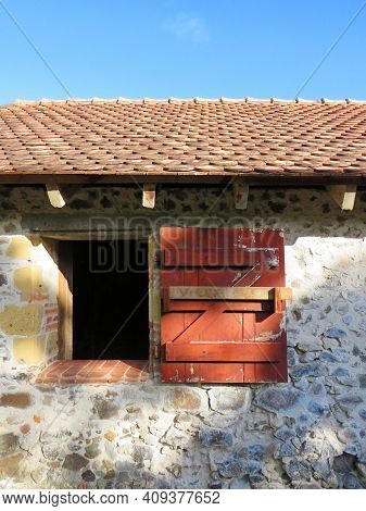 Detail Of Red Shutter And Open Window In Colonial Stone Building With Roof Under Caribbean Blue Sky.