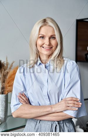 Smiling Confident Stylish 50s Middle Aged Woman Standing At Home Office. Older Businesswoman, Lady E