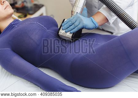 Hands Of Therapist Holding Lipomassage Tool. Beautician Doing A Beautiful Figure For A Woman. Beauti