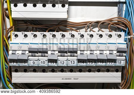 Single-phase Fuses In The Off And On Position, Placed In The Home Fuse Box, Visible Electric Wires.