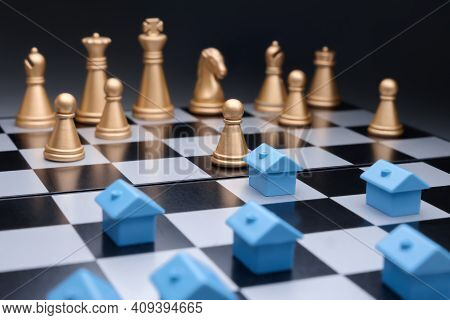 Blue Miniature Houses Property Development Strategy Planning On Chess Board. Property Management. Mo