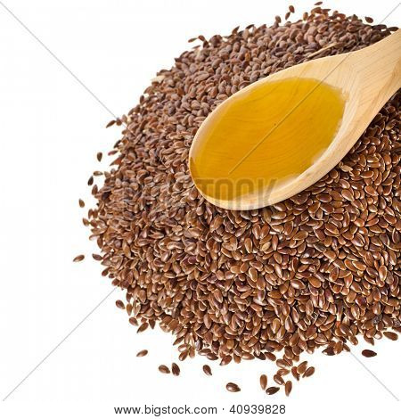 flax seed linseed and spoon oil  closeup  isolated on white background