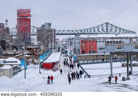 Montreal, Ca - 22 February 2021: Old Port Of Montreal, With Jacques Cartier Bridge In Background