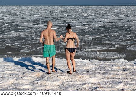 Schaslyvtseve, Ukraine - February 20, 2021: These Are Unidentified Young People In Bathing Suits On