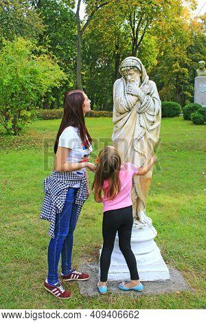 Ckachanivka Village - Chernihiv Region- Ukraine. 01 October 2017: Two Girls Admire The Monument In P
