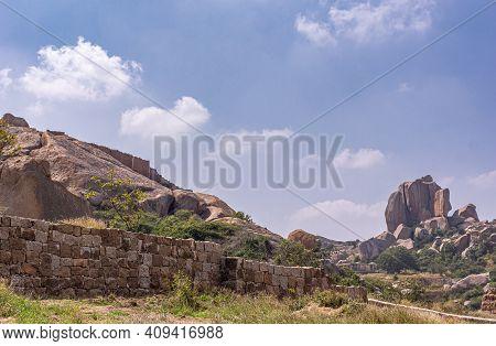 Chitradurga, Karnataka, India - November 10, 2013: Fort Or Elusuttina Kote. Brown Rocks And Stone Ra