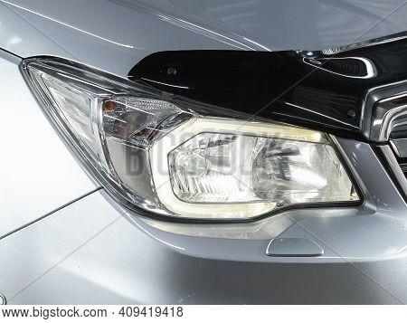 Novosibirsk, Russia - February 18 2021: Subaru Forester, Headlight Of A Modern Popular Car Close-up.