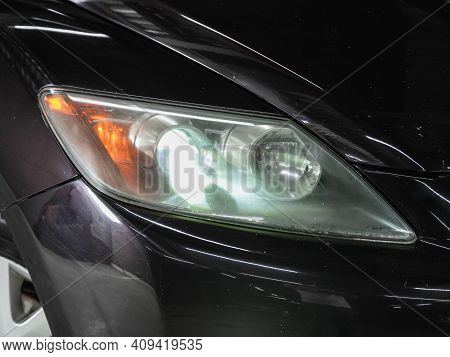 Novosibirsk, Russia - February 18 2021: Mazda Cx-7, Headlight Of A Modern Popular Car Close-up. Shin