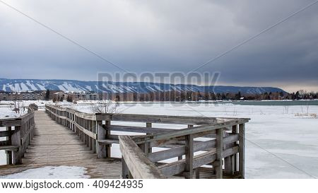 A Wooden Bridge In Lighthouse Point, Collingwood, Crosses A Portion Of Georgian Bay While Overlookin