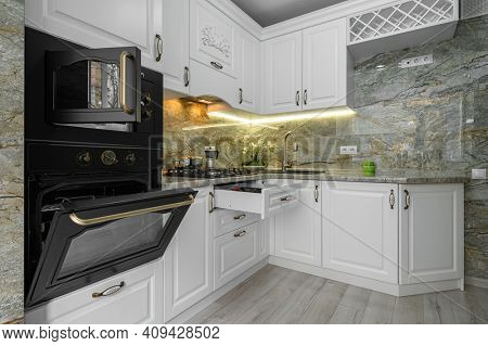 Modern classic luxury white kitchen interior, electric and microwave ovens doors are open