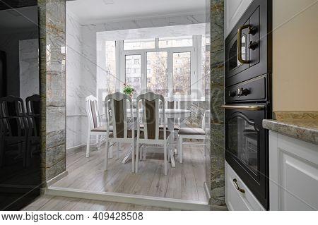 Modern classic luxury white kitchen interior with dining zone