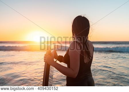 Woman With Bodyboard Entering The Ocean At Sunset, Moana Beach, South Australia