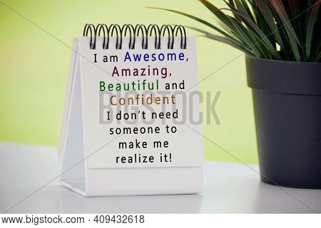 Inspirational Quote On White Paper Stand With Potted Plant And Blurred Background - I Am Awesome, Am