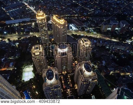 Pakubuwono Skyline Aerial Drone View From Above At Night, Jakarta Downtown Skyscrapers Cityscape And