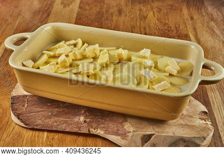 Potatoes With Mushrooms In Special Shape On Wooden Stand Before Roasting In The Oven. Step By Step R